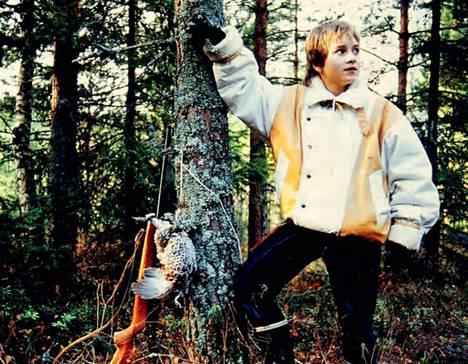 Paasi harrasti metsästystä jo varhaisteini-iässä. Kuva on muutamaa vuotta ennen kohtalokasta ampumistapausta.