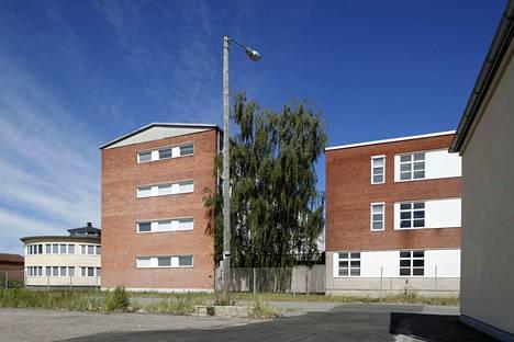 Rauma-Repolan entiset konttorirakennukset saavat väistyä. Vasemmalla näkyvä pyöreä rakennus kuitenkin säästetään.