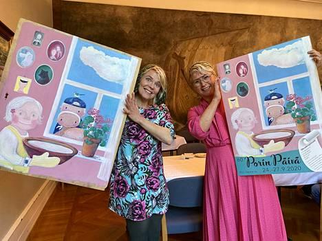 Heli Laaksonen (vasemmalla) maalasi Porin päivän julisteen kuvan alun perin peilioven peittolevylle. Elina Wallin taas teki julisteen tekstit ohrankryynivelliresepteineen.