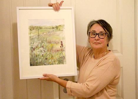 Kuorevesiläinen Outi Koho on maalannut useita kotiseutuaan Kuorevettä kuvaavia tauluja.
