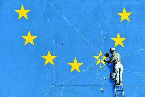 Britannian EU-eroa on tähän päivään asti viitoittanut unionin perussopimus. Nyt osapuolten pitää sopia, miten eroprosessi jatkuu. Katutaiteilija Banksyn tekemä graffiti kuvattiin Doverin satamassa helmikuussa.